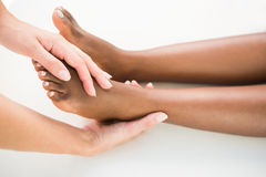 Close-up of a young woman receiving foot massage Royalty Free Stock Photo