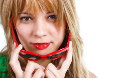Close-up of young woman with red sunglasses Royalty Free Stock Image