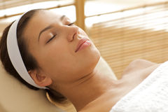 Close-up of young woman relaxing on massage table, eyes closed Royalty Free Stock Photos