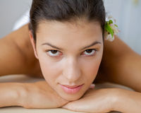 Close-up of young woman relaxing on massage table Stock Images
