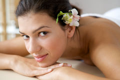 Close-up of young woman relaxing on massage table Royalty Free Stock Images