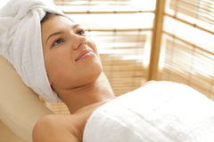 Close-up of young woman relaxing on massage table Royalty Free Stock Image