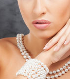 Close-up of a young woman's face in jewelry Stock Image