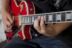 Close-up of young woman's hand playing guitar Royalty Free Stock Images