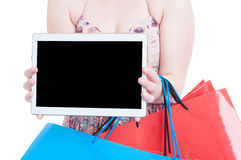 Close-up of young woman showing tablet with blank display Stock Photography