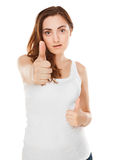 Close-up of young woman showing thumbs up (focus on face) Stock Photos