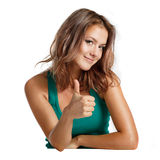 Close-up of a young woman showing thumbs up Stock Image