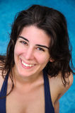 Close-up of a young woman smiling. Close-up of a young woman, looking at camera, smiling and relaxing in the swimming pool Stock Photos