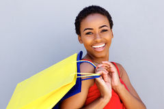 Close up young woman smiling with shopping bags Royalty Free Stock Photo