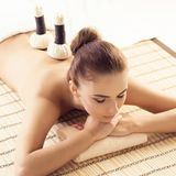 Close-up of young woman in spa. Traditional healing therapy and massaging treatments. stock photos