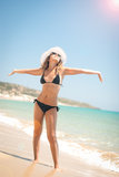 Close-up of a young woman with sunglasses sunlight. On the beach Royalty Free Stock Photography