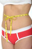 Close Up of a Young Woman With a Tape Measure Tied Around Her Waist Royalty Free Stock Images