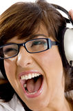 Close up of young woman tuned to music Stock Image