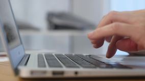 Close-up of a young woman typing on a laptop keyboard.  stock video footage