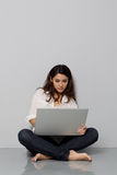Close-up of young woman using laptop Royalty Free Stock Photography