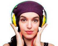 Close up of a Young Woman wearing a Black Polka-Dot dress and Li. Stening to Headphones Stock Photography