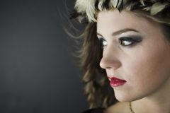 Close-up of young woman wearing feather hat. Close-up of young beautiful woman wearing vintage feather hat Royalty Free Stock Photos