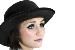 Close-up of young woman wearing hat over white background Royalty Free Stock Photography
