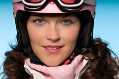 Close-up of young woman wearing pink ski helmet Stock Photos