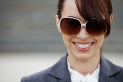 Close-up of a young woman wearing sunglasses Stock Image