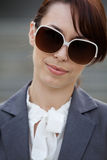 Close-up of a young woman wearing sunglasses Stock Photography
