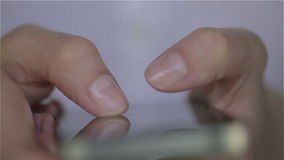 Close up of young woman white dress fingers typing on her smartphone. Close up stock footage