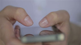 Close up of young woman white dress fingers typing on her smartphone stock footage