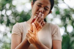 Close up young woman wrist pain royalty free stock images