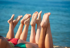 Close up of young women lying on beach Royalty Free Stock Photo