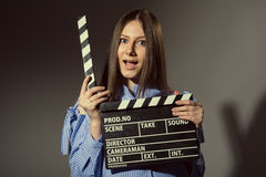 Close-up of a young women with movie clapper Stock Images