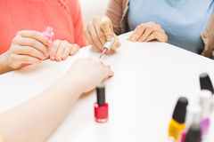 Close up of young women with nail polish Royalty Free Stock Photo