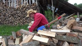 Young worker man gather wood in hand at village yard. 4K. Close up of young worker man gather wood in hand at village yard. 4K UHD video clip stock footage