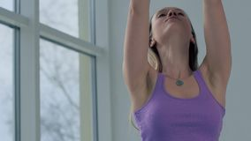 Close-up of young yoga girl enjoying her yoga practice stock footage