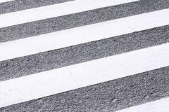 Close-up Zebra Pedestrian Crossing. In sunny day Stock Photo