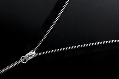 Close up of zipper on black background. Royalty Free Stock Images