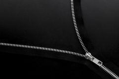 Close up of zipper on black background. Close-up of clothes fastener. Parts made âEUR stock image