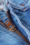 Close Up of zipper in blue jeans. Royalty Free Stock Photography