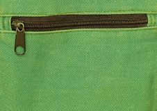 Close Up of Zipper on Green Bag background Royalty Free Stock Photo