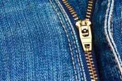 Close up of a zipper over blue denim Stock Photos