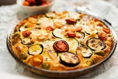 Close-up of Zucchini, tomatoes and cheese tart. Delicious baked savoury tart made of zucchini, tomatoes, salmon an cheese stock photography
