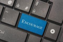 Close-upbeeld van Encourage knoop van toetsenbord van een moderne computer royalty-vrije stock afbeelding
