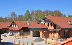 Close upBuilding site with new homes under construction. Suburbs. on foundation waterproofing, vapor barrier. Building new house. Stock Photos