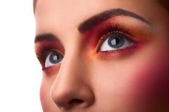 Close-upfoto van schoonheids roze en oranje make-up stock fotografie