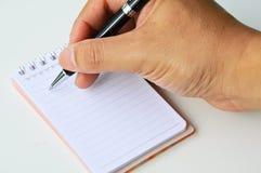 Close-uphand het schrijven nota's Royalty-vrije Stock Fotografie