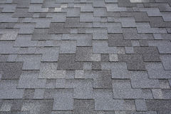 Close-upmening over Asphalt Roofing Shingles Background Dakdakspanen - Dakwerk royalty-vrije stock afbeelding