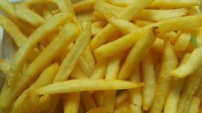 Close-upmening van aardappelfrieten of geroosterde plakken royalty-vrije stock foto