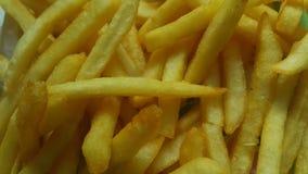 Close-upmening van aardappelfrieten of geroosterde plakken stock foto