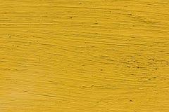 close-upmening van geel gekrast beton stock afbeeldingen