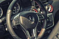 Close upMercedes AMG steering wheel and cockpit Royalty Free Stock Photos