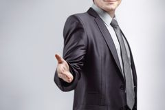 close upp affärsmannen fördjupa hans hand för att hälsa Isolerat på grå bakgrund fotografering för bildbyråer